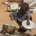 Child cooking in a refugee camp, Kenya